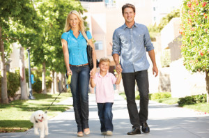 family-walking-dog